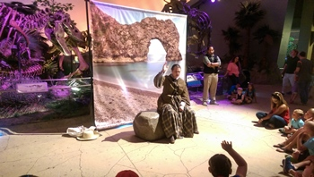 "An actor plays ""Mary Anning"" in the Dinosphere at The Children's Museum of Indianapolis. Indianapolis, IN."