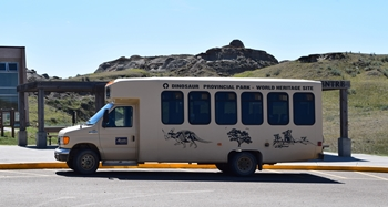 Ready to go! Dinosaur Provincial Park tour bus. Dinosaur Provincial Park, Alberta, Canada.