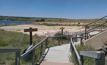 Boardwalk at the Clayton Lake State Park dinosaur tracksite. Clayton, NM.