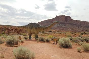 A sauropod and baby stand along the Dinosaur Trail at Moab Giants, Moab, UT.