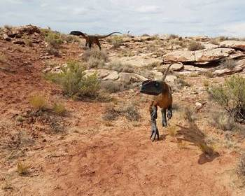 Two carnivorous dinosaurs looking for food on the Moab Giants dinosaur trail, Moab, UT.