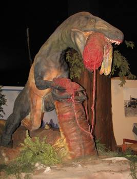 A bloodthirsty Utahraptor with the head and neck of a sauropod in its jaws. Dinosaur Journey Museum of Western Colorado, Fruita, CO.