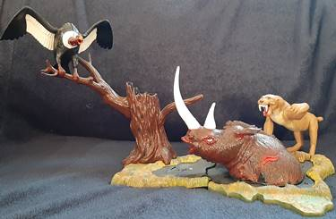 "My beloved Aurora Prehistoric Scenes ""Tar Pit"" model.  The vulture has had some rough years, but the woolly rhinoceros is still holding on..."